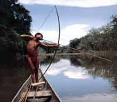 Native hunting fishes with                     arch and bow